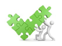 Team and check mark from puzzles Royalty Free Stock Photos