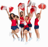 Team of cheerleaders jumping of joy on white Stock Photography