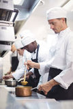 Team of chef preparing food in the commercial kitchen. At restaurant stock photos