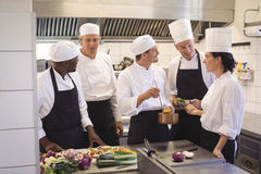 Team of chef tasting food in the commercial kitchen Royalty Free Stock Images