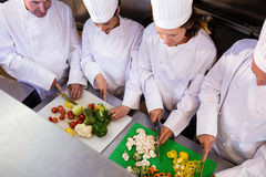 Team of chefs chopping vegetables Stock Photography