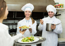 Team of chefs at kitchen Stock Image