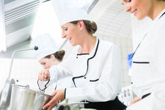Team of chefs in production process of system catering Stock Photography