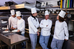 Team of chefs standing together in commercial kitchen Stock Photography