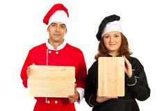 Team of chefs with wooden board Stock Photos