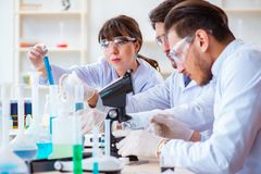 The team of chemists working in the lab Royalty Free Stock Photography