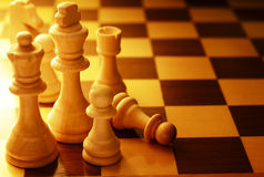 Team of chess pieces on a chessboard Royalty Free Stock Photography