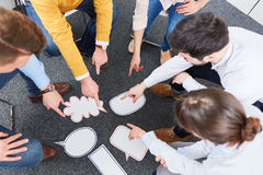 Team in circle at team building workshop Royalty Free Stock Image
