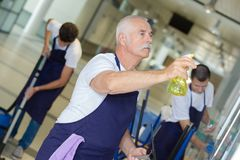 Free Team Cleaners At Work In Office Building Stock Images - 101435484