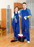 Team cleaning in room Royalty Free Stock Photography