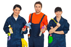 Team of cleaning workers. Team of three cleaning workers holding cleaning products isolated on white background stock images