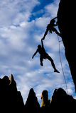 Team of climbers in danger. Team of climbers in trouble clinging to a cliff for dear life in The Sierra Nevada Mountains, California Royalty Free Stock Photos
