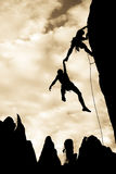 Team of climbers in danger. Stock Photography