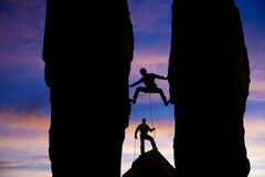 Team of climbers reaching the summit. Royalty Free Stock Images