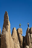 Team of climbers reaching the summit. Royalty Free Stock Photography