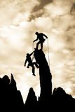 Team of climbers reaching the summit. Royalty Free Stock Image