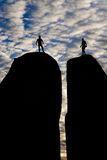 Team of climbers reaching the summit. Stock Image