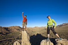 Team of climbers on the summit. Royalty Free Stock Images