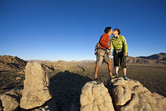 Team of climbers on the summit. stock image