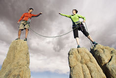 Team of climbers on the summit. Royalty Free Stock Photos