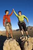 Team of climbers on the summit. royalty free stock photography