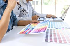 Team of colleague graphic designer drawing and retouching image stock image
