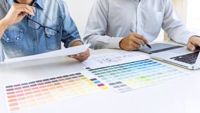 Team of colleague graphic designer drawing and retouching image royalty free stock photography