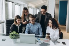 Team of colleagues brainstorming together while working on the computer.  royalty free stock image
