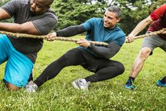 Team competing in tug of war royalty free stock photography