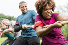 Team competing in tug of war stock image