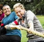 Team competing in tug of war royalty free stock photo