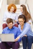 Team con il pc della compressa e del computer portatile sulla scala Fotografia Stock Libera da Diritti