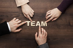 Team concept on the brown wooden table background Stock Image