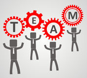 Team concept - people pick up gear Stock Photo