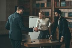 Team concept. University students training in team building in library. Crisis management team. Project team at work. We. Work together for success royalty free stock images
