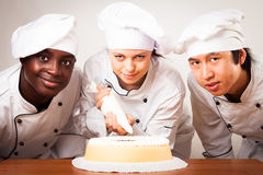 Team Of Confectioners With Gateau royalty free stock photography