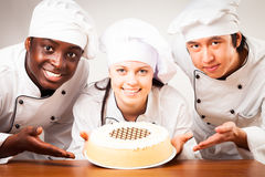 Team Of Confectioners With Gateau stock photography