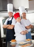 Team Of Confident Chefs Royaltyfri Bild
