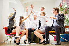Team congratulates each other with a group high five Royalty Free Stock Image