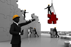 Team constructing jigsaw puzzle Royalty Free Stock Images