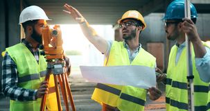 Team of construction engineers working on building site royalty free stock image