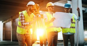Team of construction engineers working on building site stock images