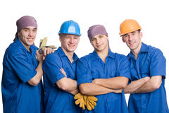 Team of construction workers. A friendly young team of construction workers. Isolated on white Royalty Free Stock Photos