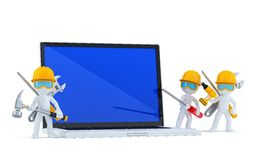 Team of construction workers with blank screnn laptop. Isolated. Contains clipping path Royalty Free Stock Image