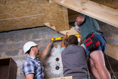 Team of Construction Workers Building Staircase Stock Images