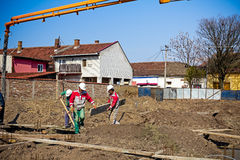 Team of construction workers are preparing site for concreting. Royalty Free Stock Photography