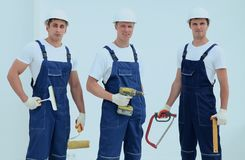 Team of construction workers with working tools Stock Photography
