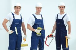 Team of construction workers with working tools Royalty Free Stock Image