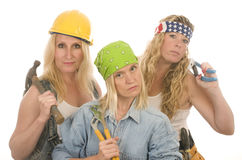 Team contractor construction ladies tools. Group of sexy contractor or builder or homemaker females construction workers with electric power tools Royalty Free Stock Photos