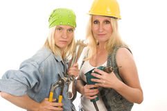 Team contractor  ladies with tools. Group of sexy contractor or builder or homemaker females construction workers with electric power tools Stock Photos